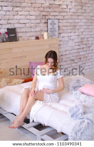 American or european young pretty woman sitting on bed in bright Stock photo © HASLOO