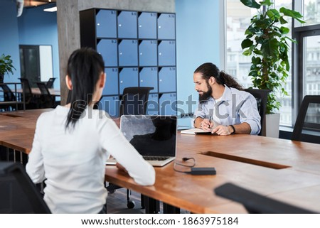 Young adult man writing in his copybook while sitting on a large Stock photo © HASLOO