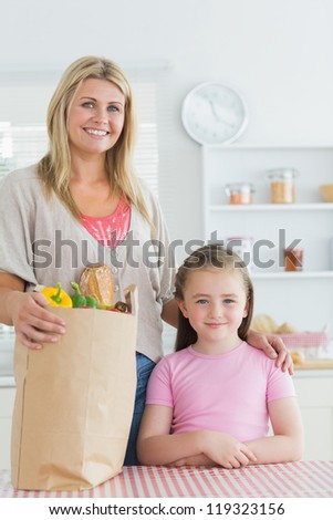 fair-haired girl  with shopping bags standing on table beside giant red pumps Stock photo © photography33
