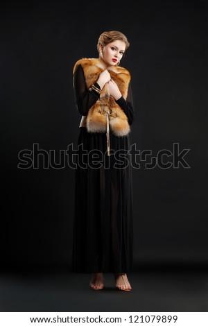 Zdjęcia stock: Fashion Model In Black Dress And Fox Fur Mantle - Glamour Style