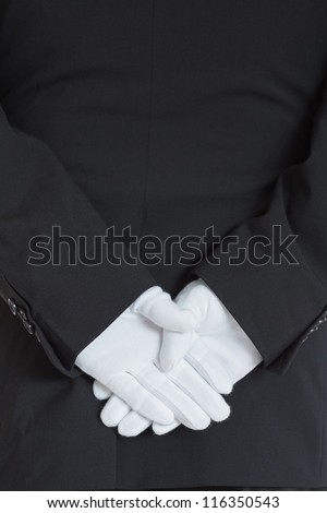 close-up rear side of a waiter wearing gloves with hands clasped Stock photo © wavebreak_media