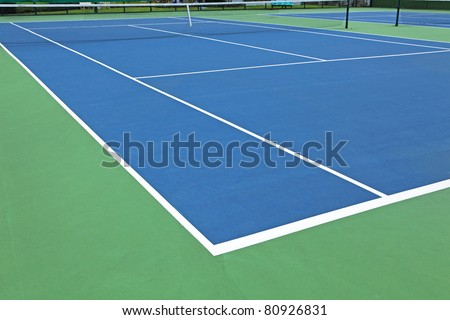 Tennis sport concept with a ball flying over the court net or netting as a leisure fitness and exerc Stock photo © Lightsource