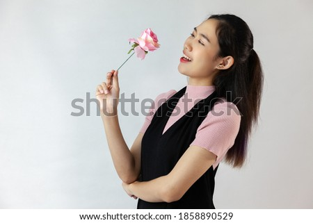 beautiful young woman with flowers in their hair looks at the ca stock photo © nikkos