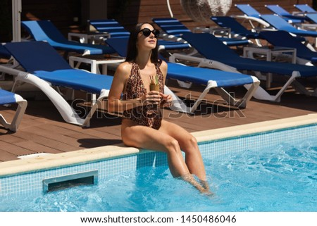 Attractive young girl sitting on the edge of a glass. Glamorous  Stock photo © balasoiu