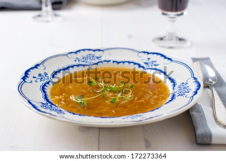 Classic french onion soup on a white wood table with some red wi Stock photo © phila54
