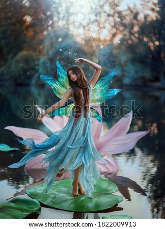 beautiful young woman with pink lily stock photo © nejron