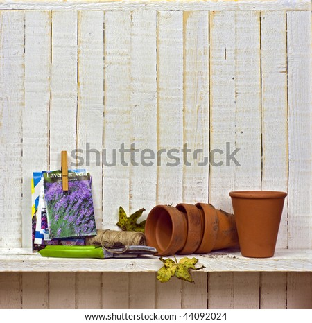 flowerpots and red flower on a white wall with copy space for te stock photo © taiga