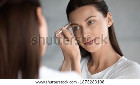 Femininity. Groomed Woman's Face with Natural Makeup. Pure Beauty Stock photo © gromovataya