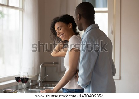 girl embraces young man for neck behind Stock photo © Paha_L