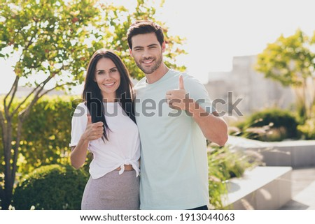 Man and girl in summer garden. Man embraces girl showing it flower. Close up. stock photo © Paha_L