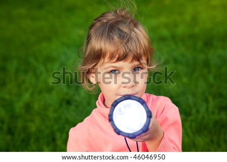 girl playing with lantern portrait of girl against a grass grass background stock photo © paha_l