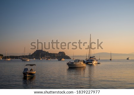 Stock photo: Ship in front of small town at the blue ocean coast with cloudy mountain background, Cape Verde isla