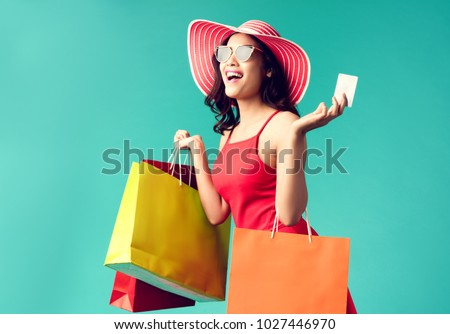 beautiful woman with shopping bags and credit card in the hands stock photo © vlad_star