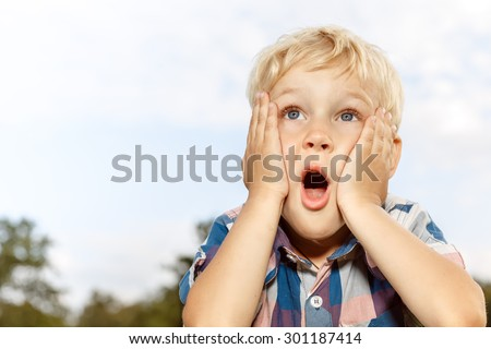 Boy looking at the sky with surprised expression. Child imagination Stock photo © photocreo