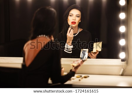 Beautiful fashion elegant brunette lady in dress with gems beads Stock photo © Victoria_Andreas