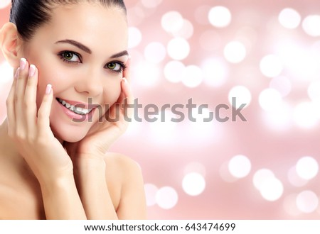 Pretty woman against an abstract background with blurred lights Stock photo © Nobilior