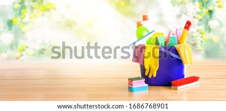 Basket with cleaning items on blurry background white citchen. C stock photo © Yatsenko