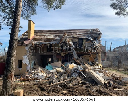 Destroyed building earthquake. Broken house war. ruined architec Stock photo © popaukropa