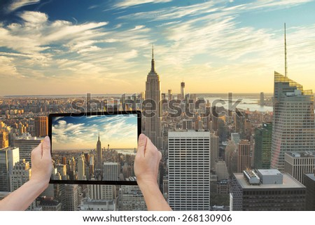 in the bottom left of the photo are hands holding tablet whose stock photo © iordani