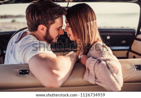 young smile couple romantic kissing sitting in car summer time stock photo © yatsenko