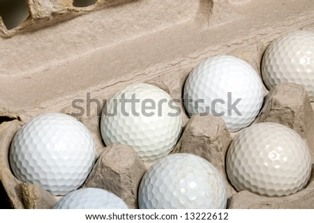 white golf balls in the box for eggs golf ball with funny cap stock photo © capturelight