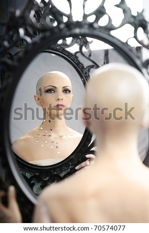 Serious looking woman for breast cancer awareness on white background Stock photo © wavebreak_media