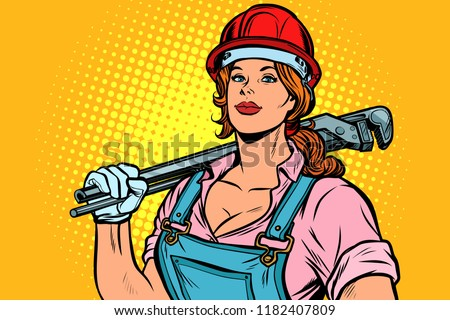 A strong woman mechanic plumber worker with adjustable wrench Stock photo © studiostoks