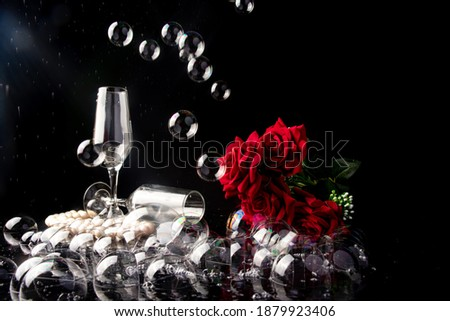 Elegant glass of pink rose champagne with bubbles on blavk marble board on black background. Space f Stock photo © DenisMArt