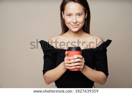 A cup of fragrant cappuccino with a smile face on a gray backgro Stock photo © artjazz