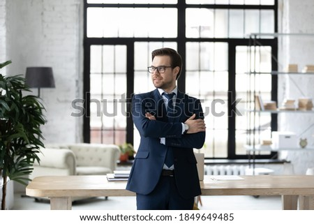 Image of optimistic businessman 30s in formal suit smiling on ca Stock photo © deandrobot