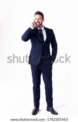 Full length image of caucasian businessman 30s in suit rejoicing Stock photo © deandrobot