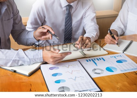 üzleti csapat adat jövedelem táblázatok irat megbeszélés Stock fotó © snowing