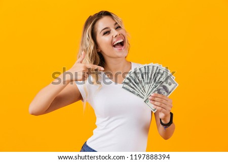 Photo of caucasian woman in basic clothing holding fan of dollar Stock photo © deandrobot