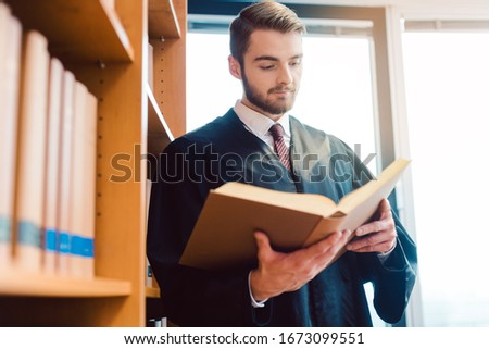 Lawyer with robe ready for court reading after the law one last time Stock photo © Kzenon