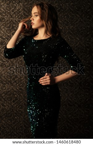 Charming model in sequin dress posing. Gorgeous model with perfect make up Stock photo © studiolucky
