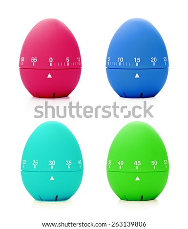 different colored eggs in the shape of a clock on a green background with copy space flat lay stock photo © artjazz