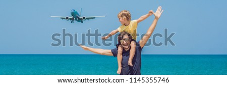 father and son have fun on the beach watching the landing planes traveling on an airplane with chil stock photo © galitskaya
