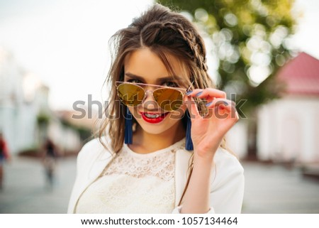 Pretty trendy girl with braid in mirrored sunglasses drinking coffee in the street. Stock photo © studiolucky