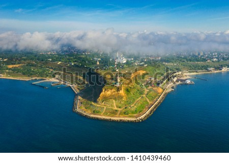 Aerial view of the drone on the city of Odessa and the sea with a maritime station against a blue sk Stock photo © artjazz