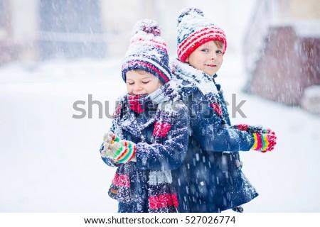 Vicces kicsi gyerek fiú színes ruházat Stock fotó © ElenaBatkova