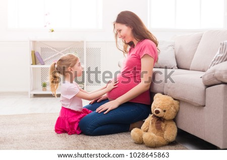 Mother with little charming daughter are sitting in the summer terrace in sunlight. They are have br Stock photo © ElenaBatkova