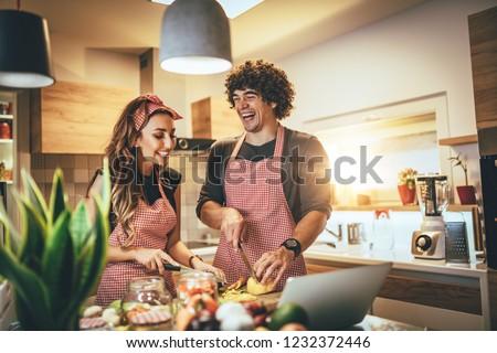 famille · occupés · ensemble · cuisine · fille · alimentaire - photo stock © boggy
