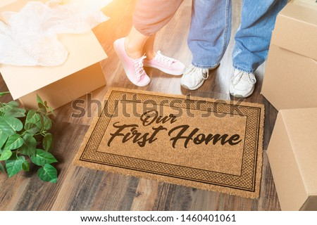 Man and Woman Unpacking Near Our First Time Buyer Welcome Mat, M Stock photo © feverpitch