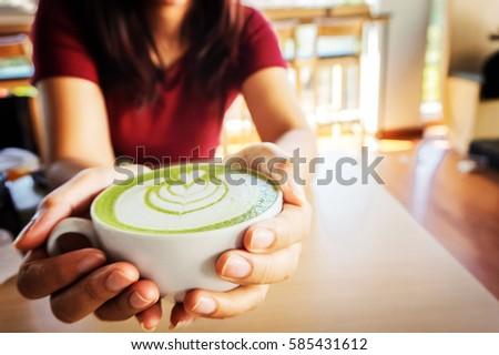Nő tart csésze forró zöld tea kezek Stock fotó © Freedomz