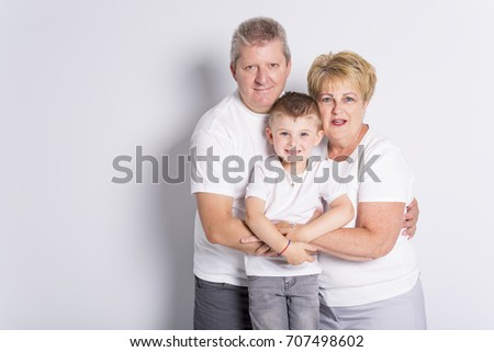 grandmother and geandfather with grandchild on light background Stock photo © Lopolo