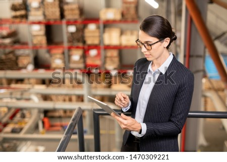 Young expert of industrial plant scrolling in tablet while surfing in the net Stock photo © pressmaster
