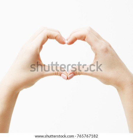 Saint Valentines Day. Minimal style. Close up of two female caucasian hands isolated on white backgr Stock photo © serdechny