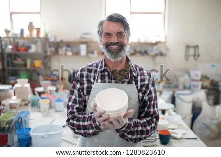 Orgoglioso maschio creazione ceramica Foto d'archivio © wavebreak_media