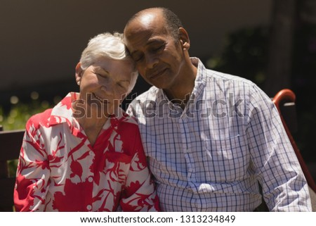 front view of soothed senior couple head to head with eyes closed in garden on a sunny day stock photo © wavebreak_media