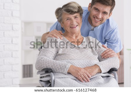 Female doctor interacting with disabled senior woman in living room at home Stock photo © wavebreak_media